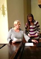Anne helps newcomer, McKenzie prepare music.