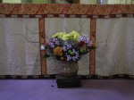 Parishioners take turns donating flowers to decorate the chapel.