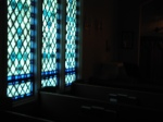 In the darkened Lady Chapel, many people find opportunities for peaceful meditation.